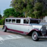 Vintage stretch limousine picking up guests for a function