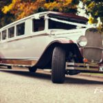 Vintage wedding limousine arriving to pick up guests